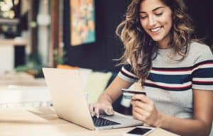 women using credit card online shopping