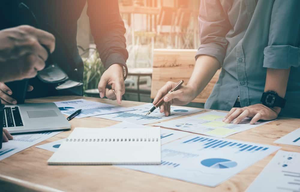 start-up analysis to data paper chart on desk