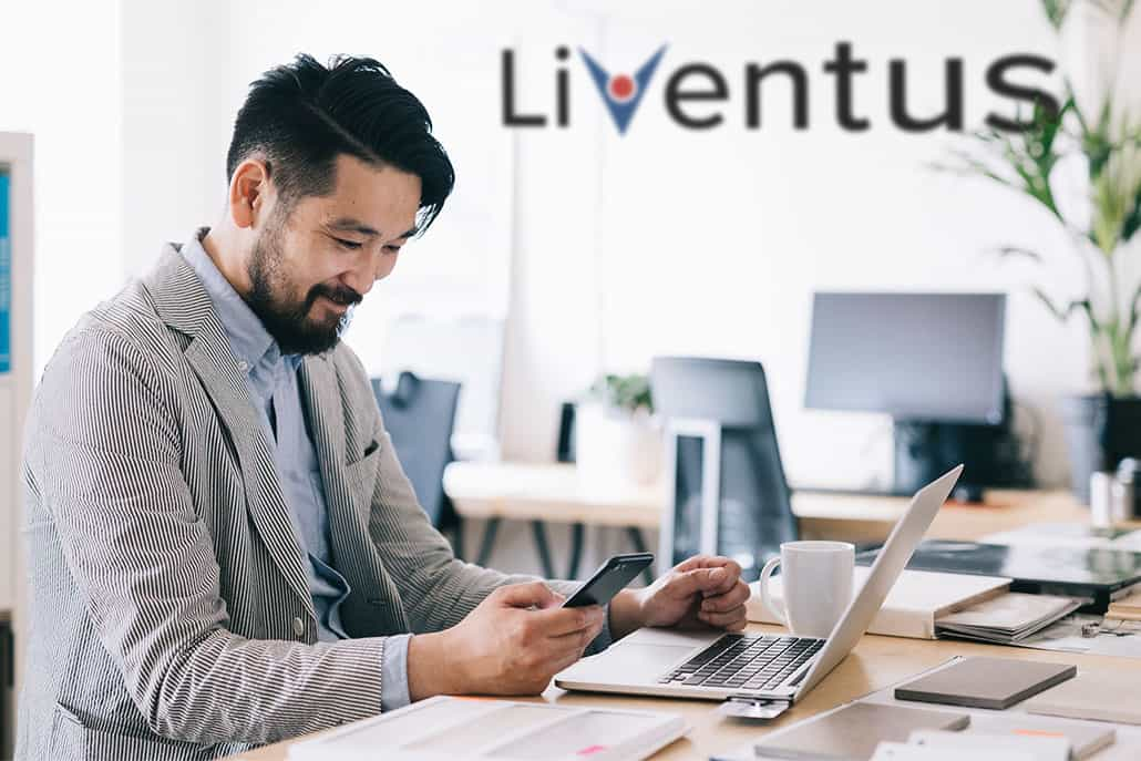 Man sitting in front of laptop at the Liventus office