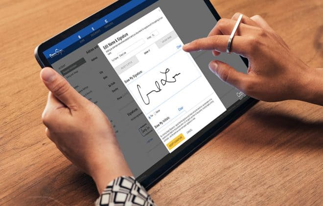 tab in a persons hand with DocuSign app open