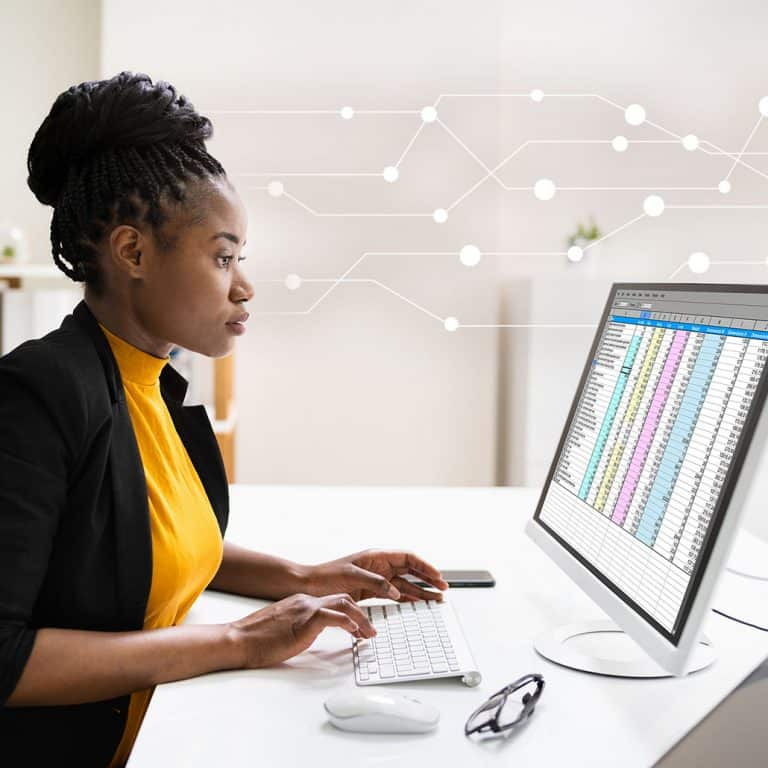 A girl working on the desktop machine